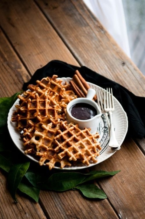 Waffles and melted chocolate sauce.